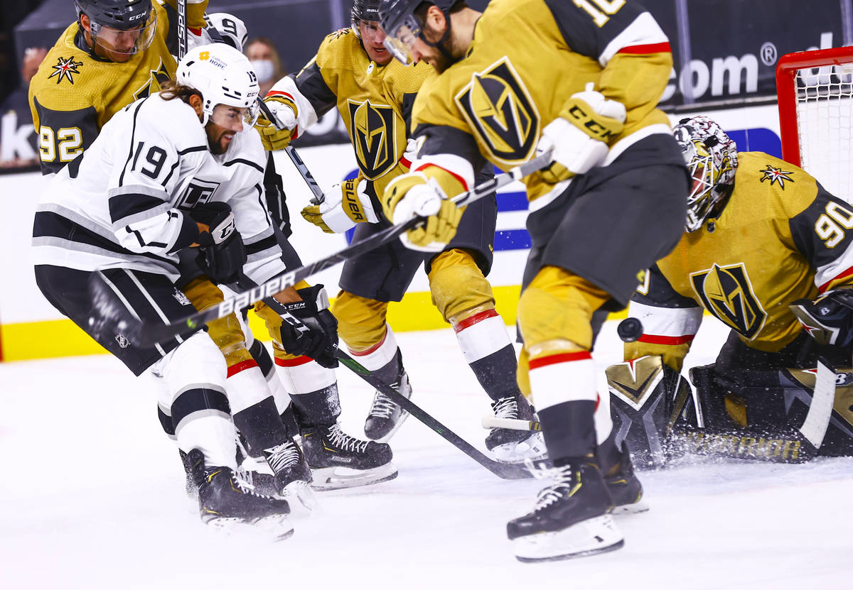 Los Angeles Kings right wing Alex Iafallo (19) attempts to get the puck past Golden Knights def ...