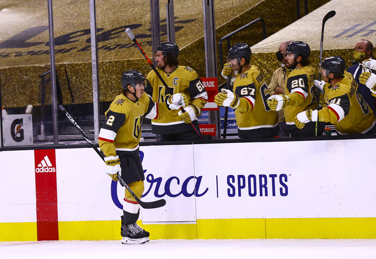 Golden Knights defenseman Zach Whitecloud (2) celebrates his goal during the first period of an ...