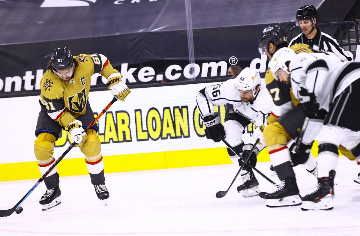 Golden Knights right wing Mark Stone (61) skates with the puck in front of Los Angeles Kings de ...