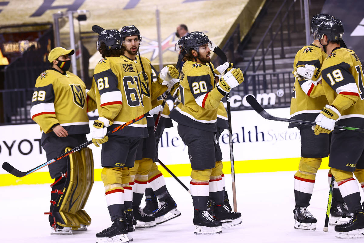Golden Knights center Chandler Stephenson (20) celebrates with teammates after helping lead the ...