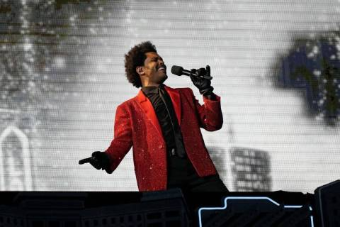 The Weeknd performs during halftime of the NFL Super Bowl 55 football game between the Kansas C ...