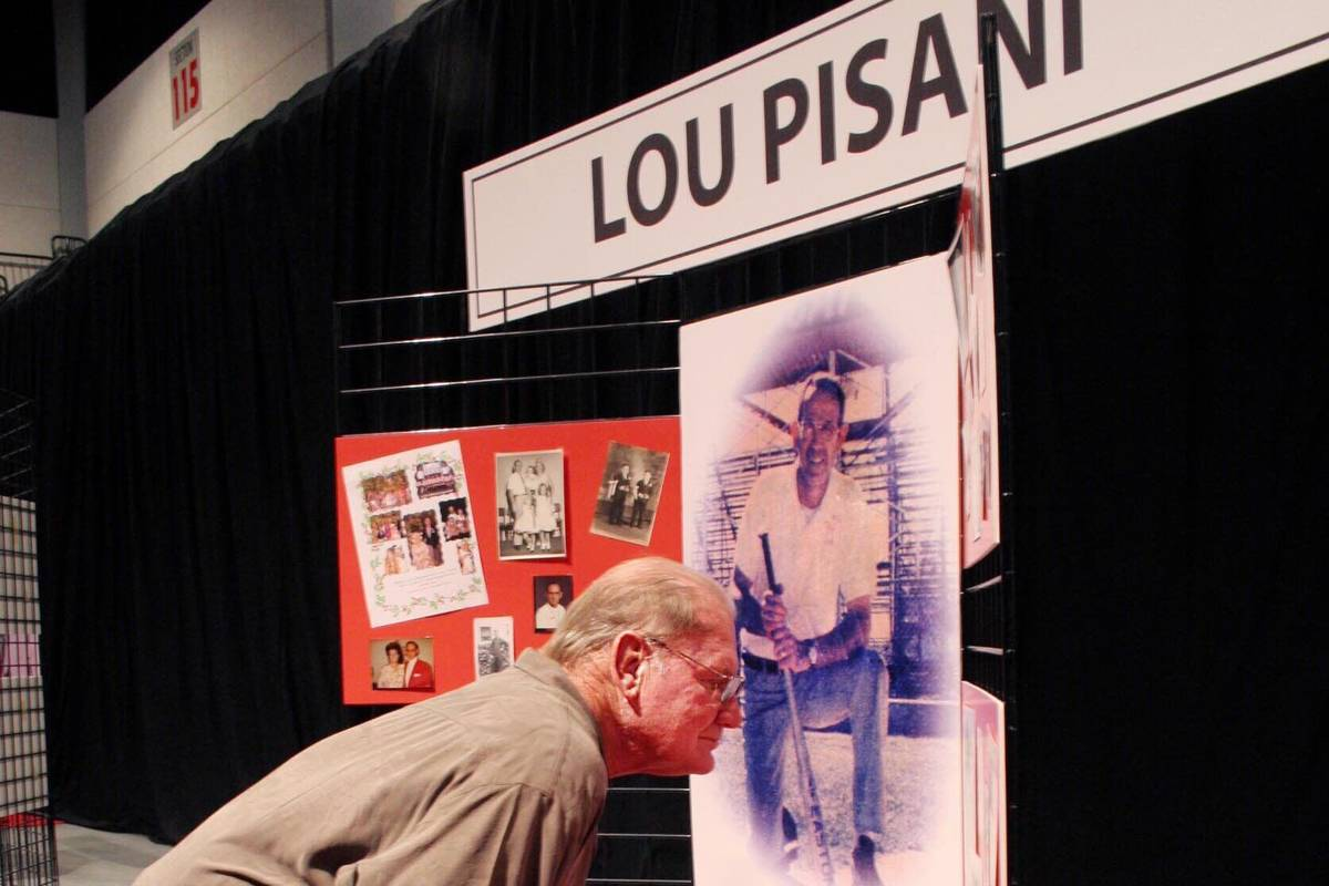 SPORTS Rick Traasdahl looks at a collection of baseball memorabilia from Lou Pisani at the Sout ...