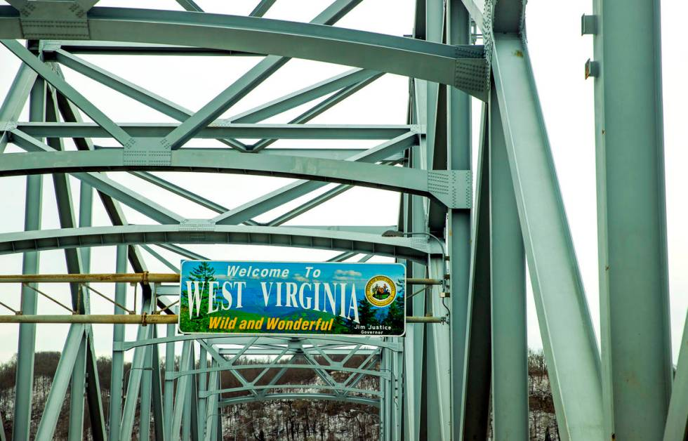 """A """"Welcome to West Virginia"""" sign greets those crossing the bridge over the Ohio Rive ..."""