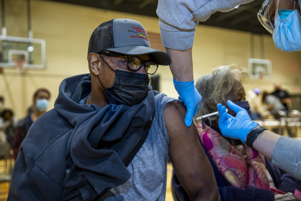 Jay Harris receives a Moderna COVID-19 vaccination at a clinic within the North Charleston Comm ...