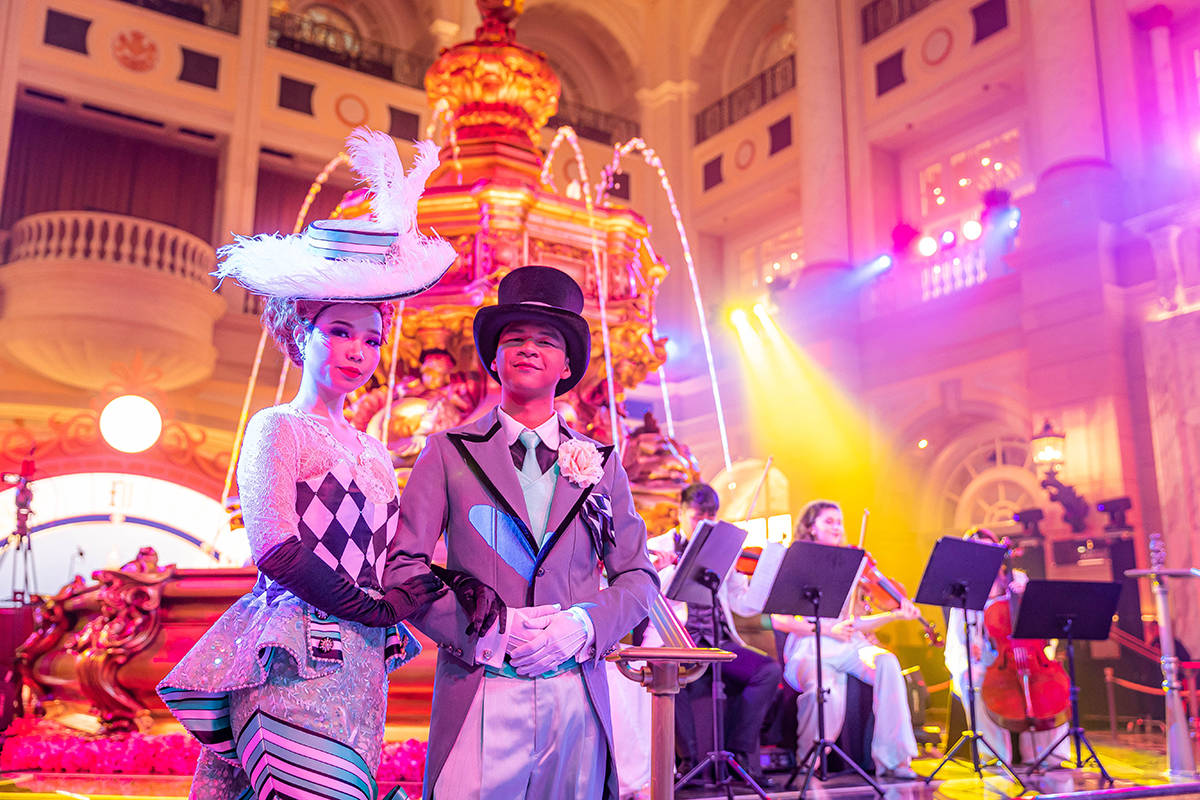 Entertainers provide a taste of London at the Monday, Feb. 8, 2021, opening of the Londoner, La ...