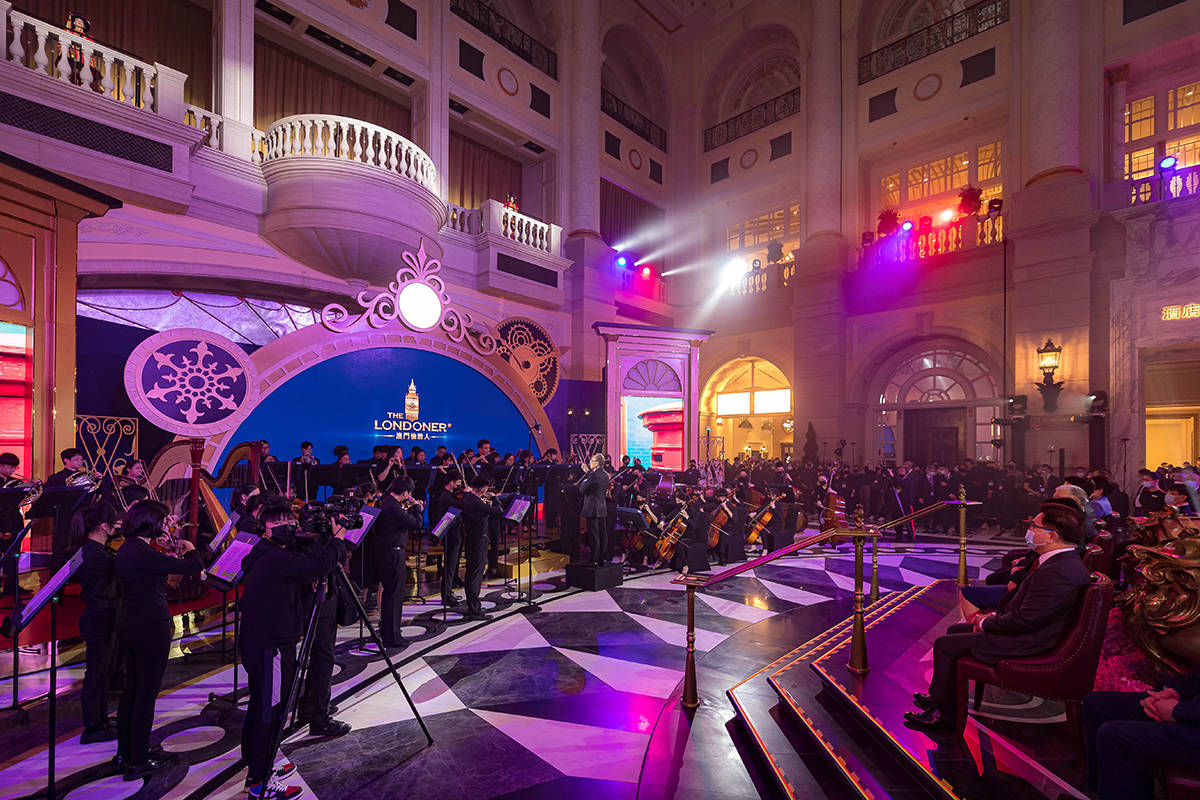 The 65-member Macau Youth Orchestra performs at the opening ceremony for the Londoner, Las Vega ...