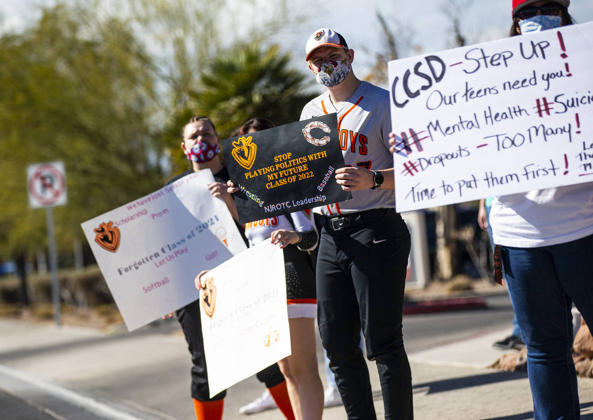 Chaparral High School baseball player Rodney Alger participates in a rally to urge school distr ...