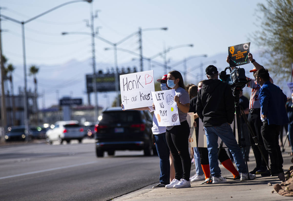 Student athletes, including Mia Perez of Western High School, participate in a rally to urge sc ...