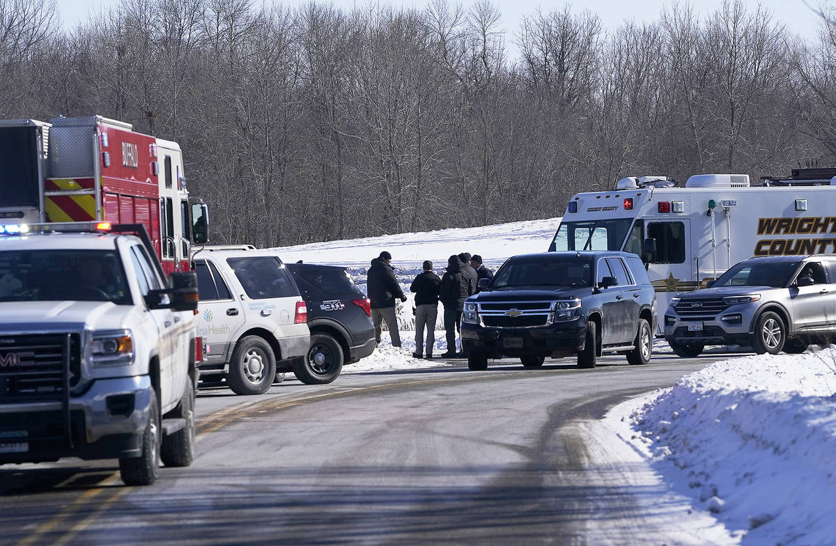 Law enforcement personnel and first responders gather outside of the Allina Health clinic, Tues ...