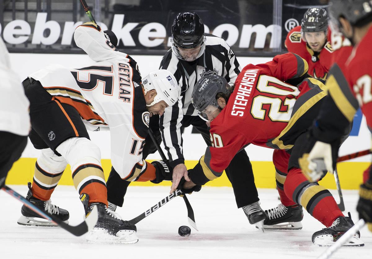 Vegas Golden Knights center Chandler Stephenson (20) faces off against Anaheim Ducks center Rya ...