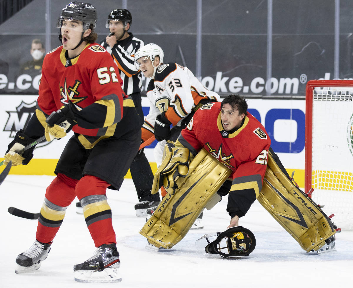 Vegas Golden Knights goaltender Marc-Andre Fleury (29) defends the net after his mask came off ...