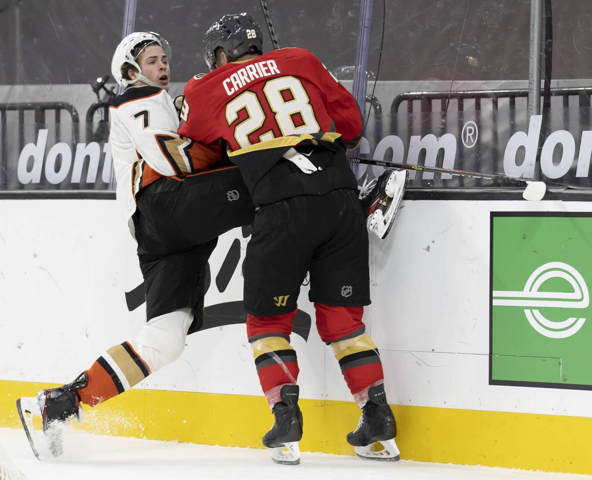 Vegas Golden Knights left wing William Carrier (28) collides with Anaheim Ducks defenseman Ben ...