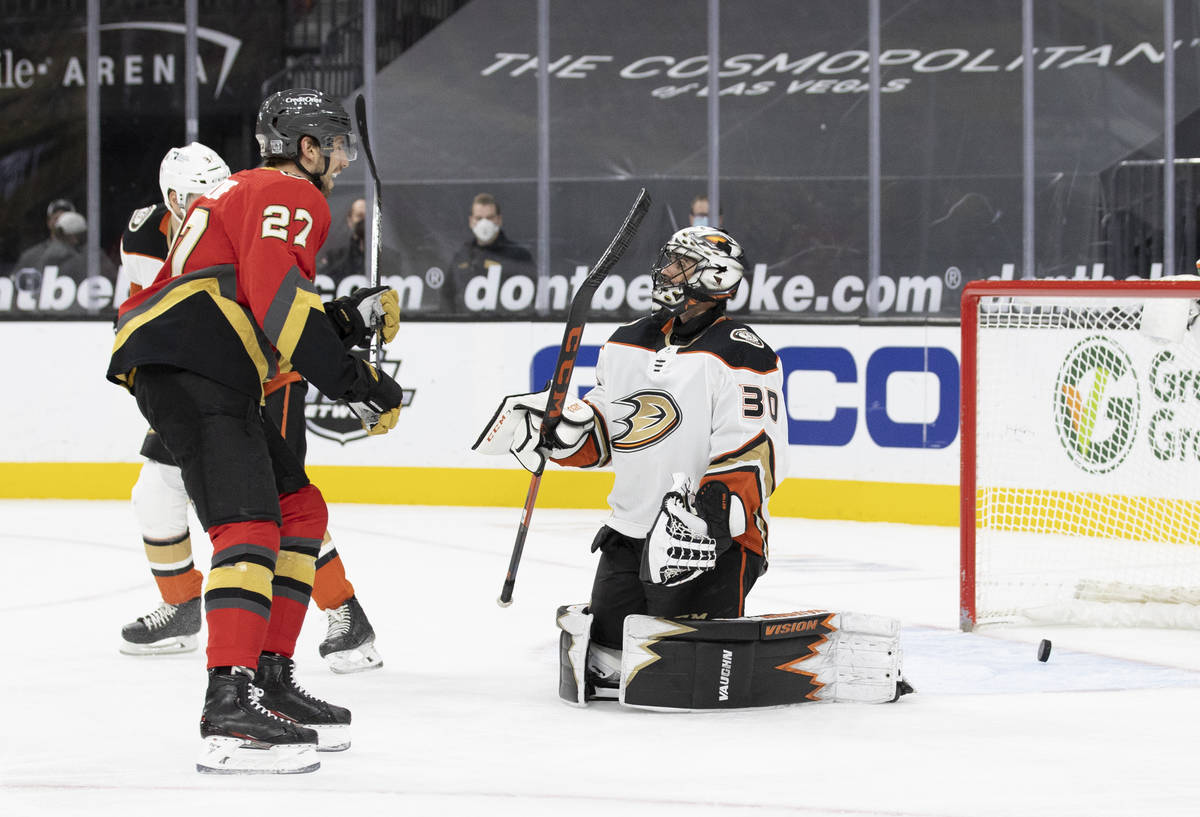 Vegas Golden Knights defenseman Shea Theodore (27) celebrates after the Knights scored a goal a ...