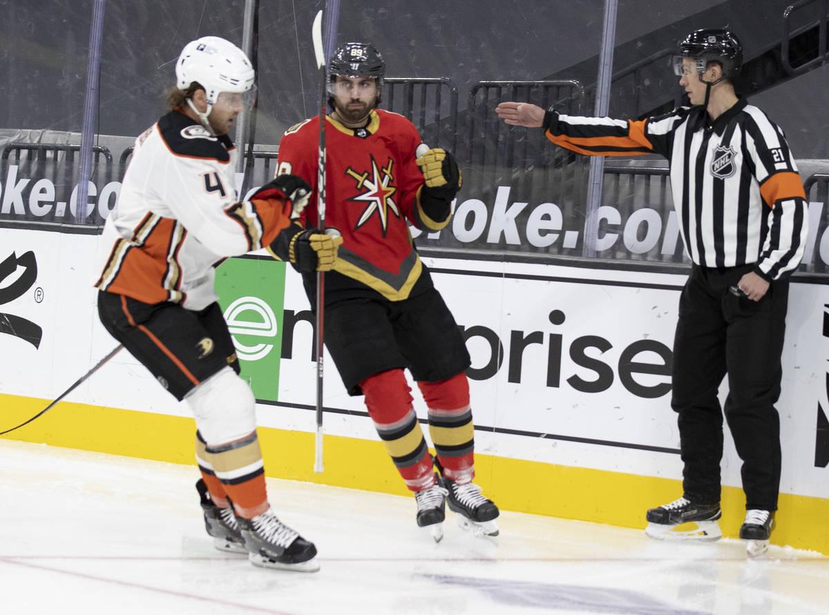 Vegas Golden Knights right wing Alex Tuch (89) celebrates in front of Anaheim Ducks defenseman ...