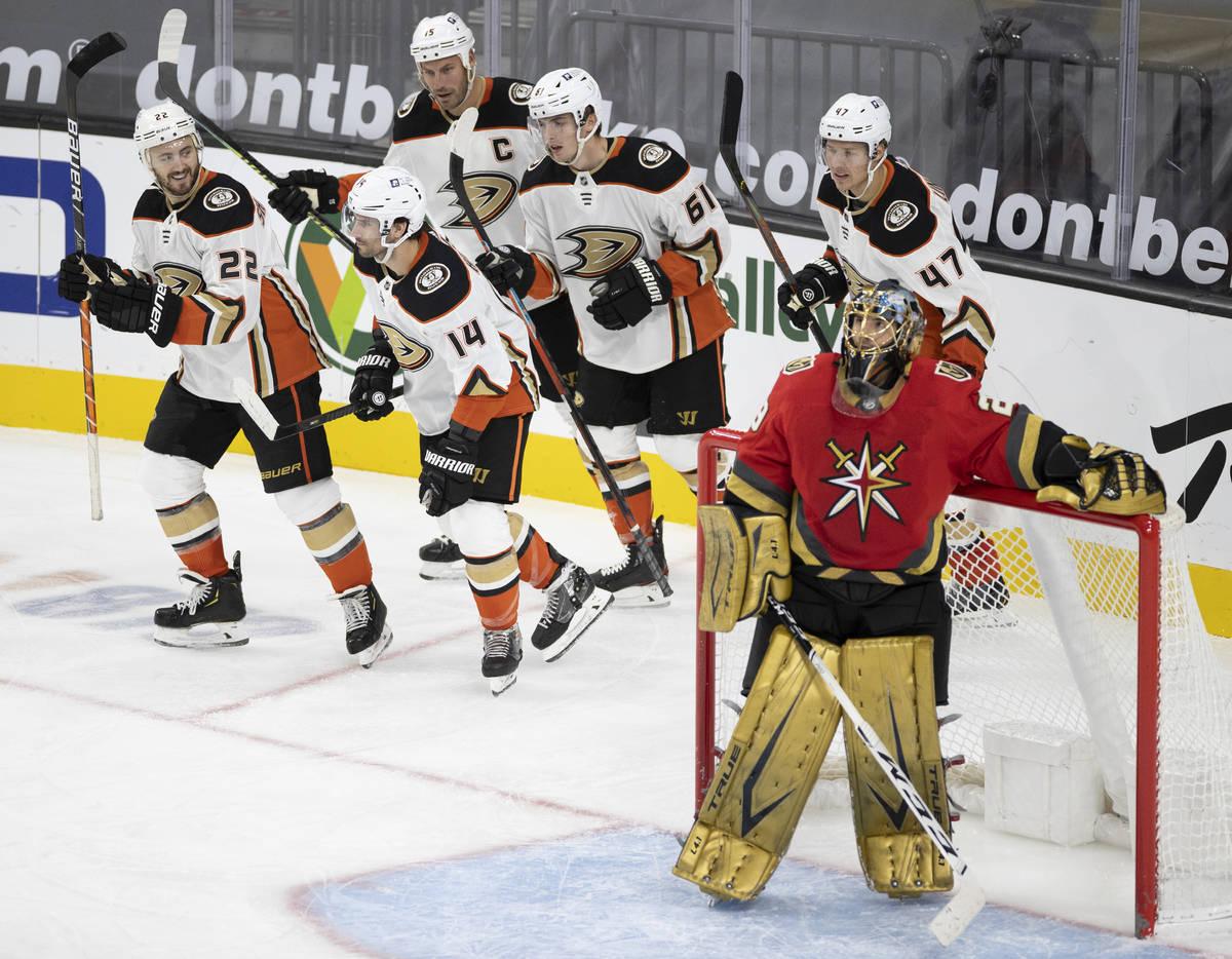 Anaheim Ducks center Adam Henrique (14) celebrates with teammates after scoring a goal against ...