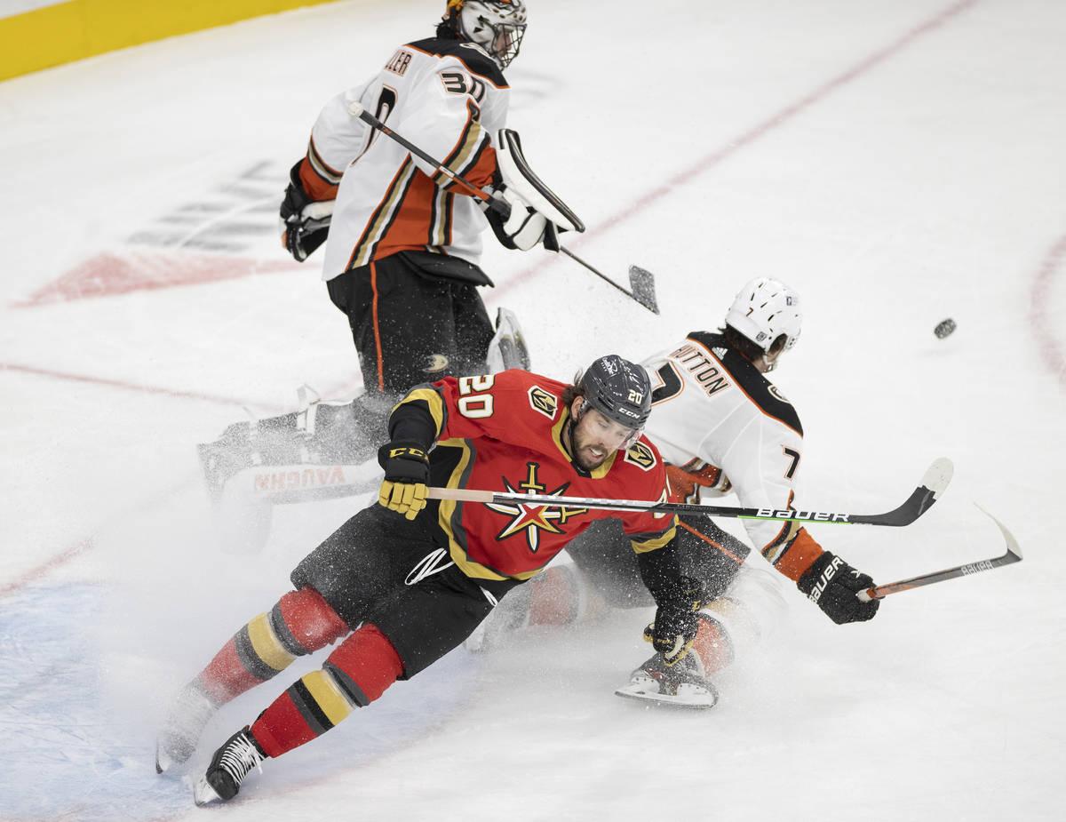 Vegas Golden Knights center Chandler Stephenson (20) collides with Anaheim Ducks defenseman Ben ...