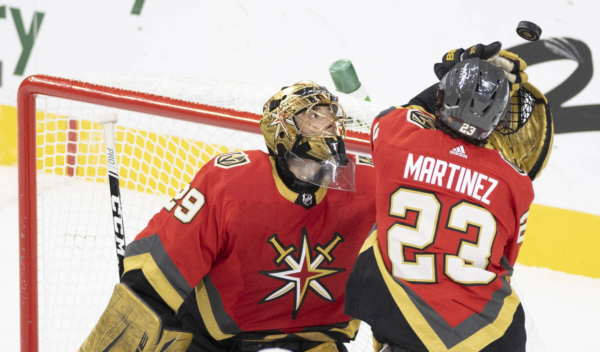 Vegas Golden Knights goaltender Marc-Andre Fleury (29) makes a save with the help of Vegas Gold ...