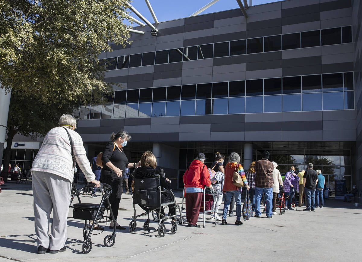 People lined up to get their second doses of vaccine at the Las Vegas Convention Center's vacci ...