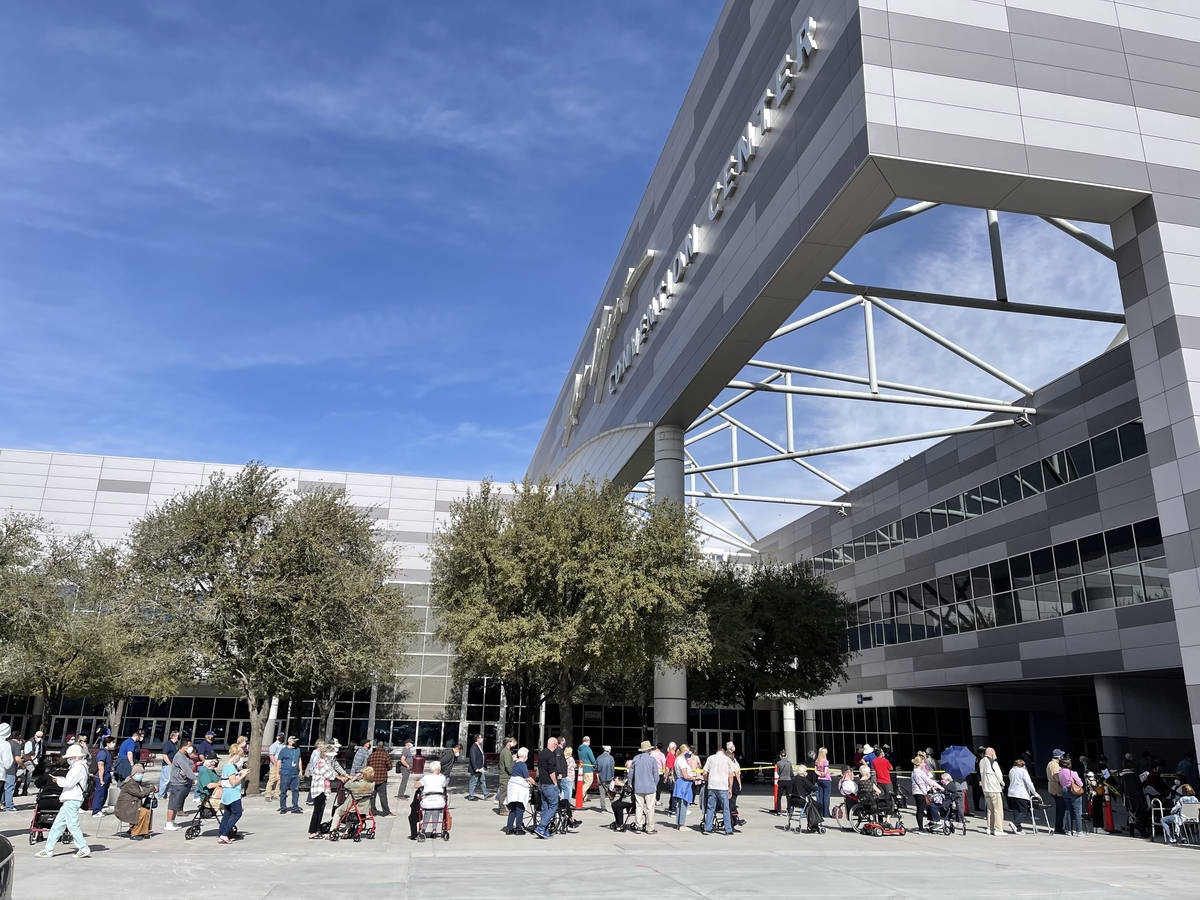 People line up for the second dose of the COVID-19 vaccine outside the Las Vegas Convention Cen ...