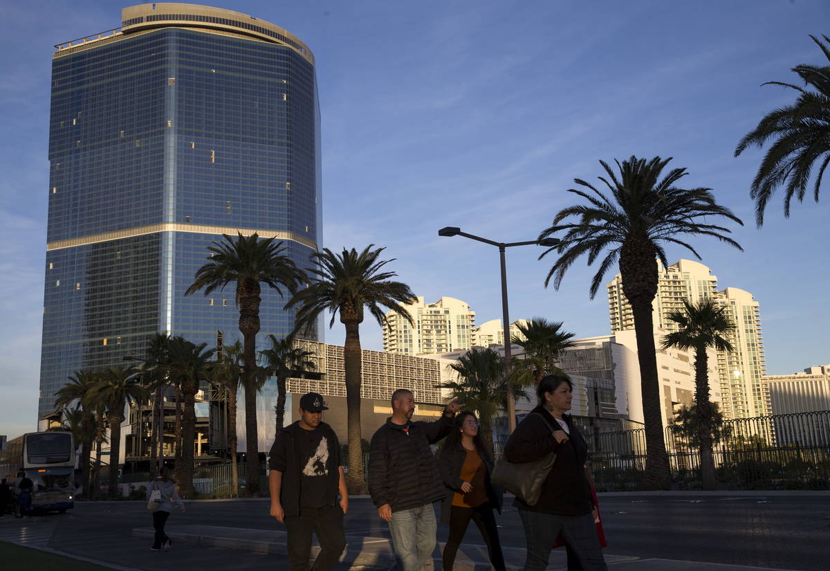 People walk past the Drew Las Vegas, formerly the Fontainebleau, on the Strip in 2017. (Las Veg ...