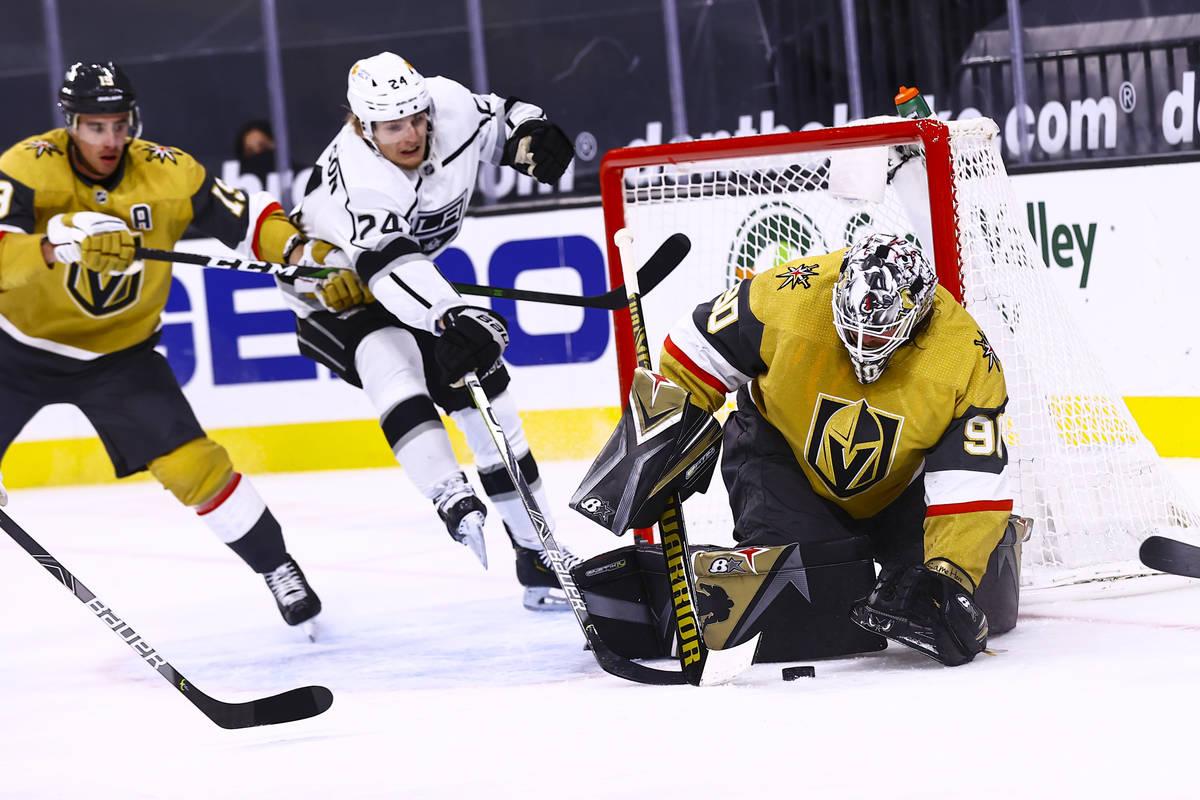 Golden Knights goaltender Robin Lehner (90) stops the puck against Los Angeles Kings center Lia ...