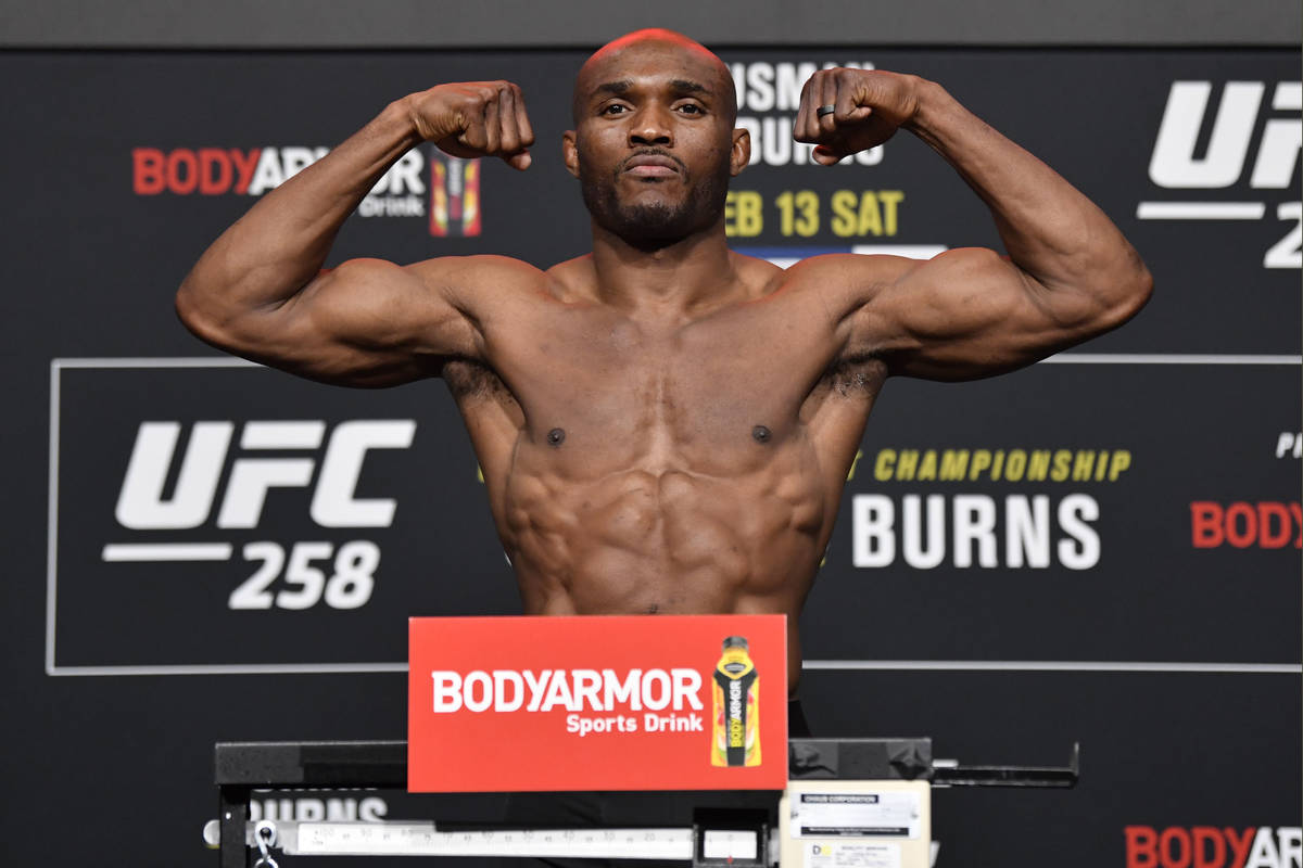 Kamaru Usman of Nigeria poses on the scale during the UFC weigh-in at UFC APEX on Friday, Feb.1 ...