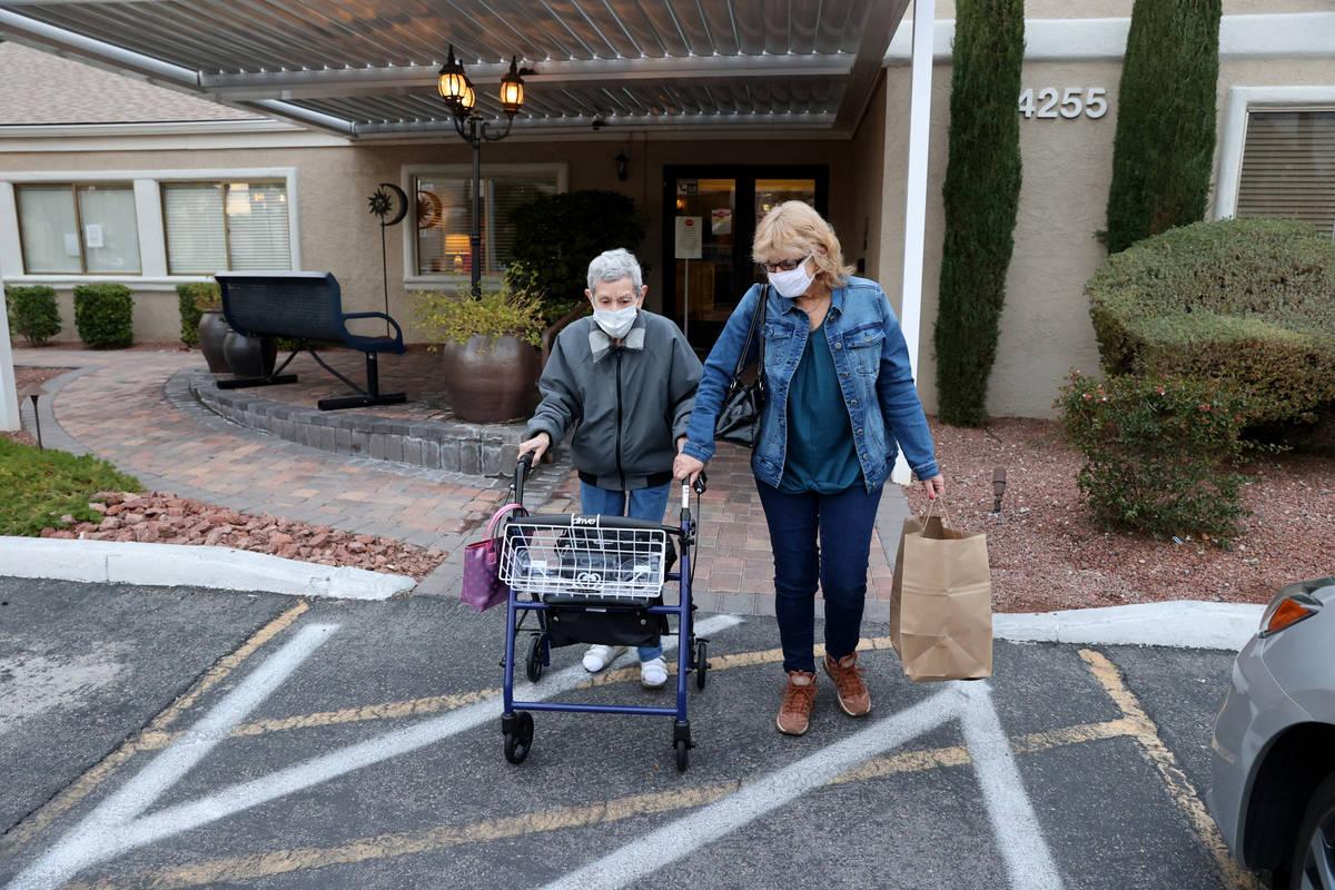 Estelle Roberts, 92, left, and her daughter Dori Roberts-Lombardi, 65, at her Las Vegas assiste ...