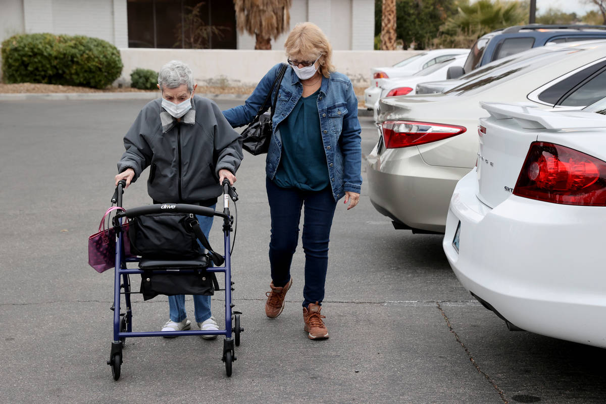 Estelle Roberts, 92, right, gets help from her daughter Dori Roberts-Lombardi, 65, before a doc ...