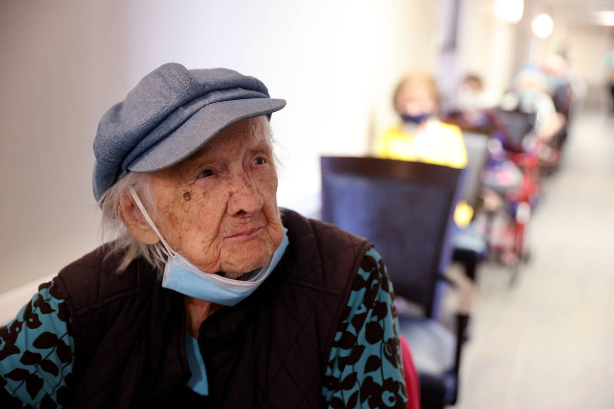 Valmae Ayres, 98, waits in line for the COVID-19 vaccine during an in-house clinic at Oakmont o ...