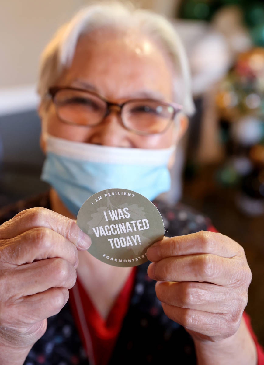 """Akiko Byers, 80, shows her """"I was vaccinated today!"""" sticker after receiving the Pfiz ..."""