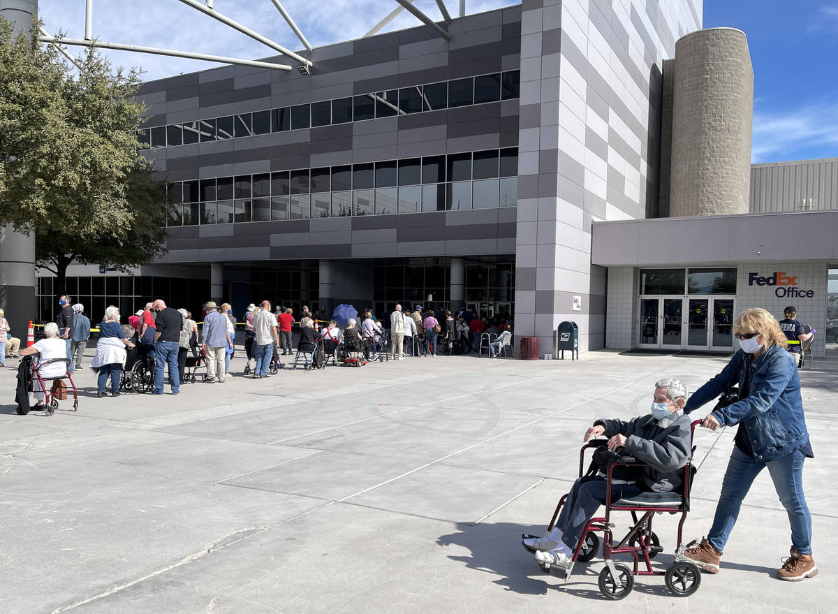 Estelle Roberts, 92, left, and her daughter Dori Roberts-Lombardi, 65, leave the Las Vegas Conv ...
