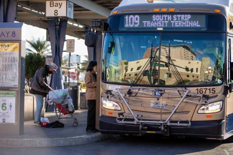 A nearby building is reflected in the front window of a bus at the Bonneville Transit Center op ...