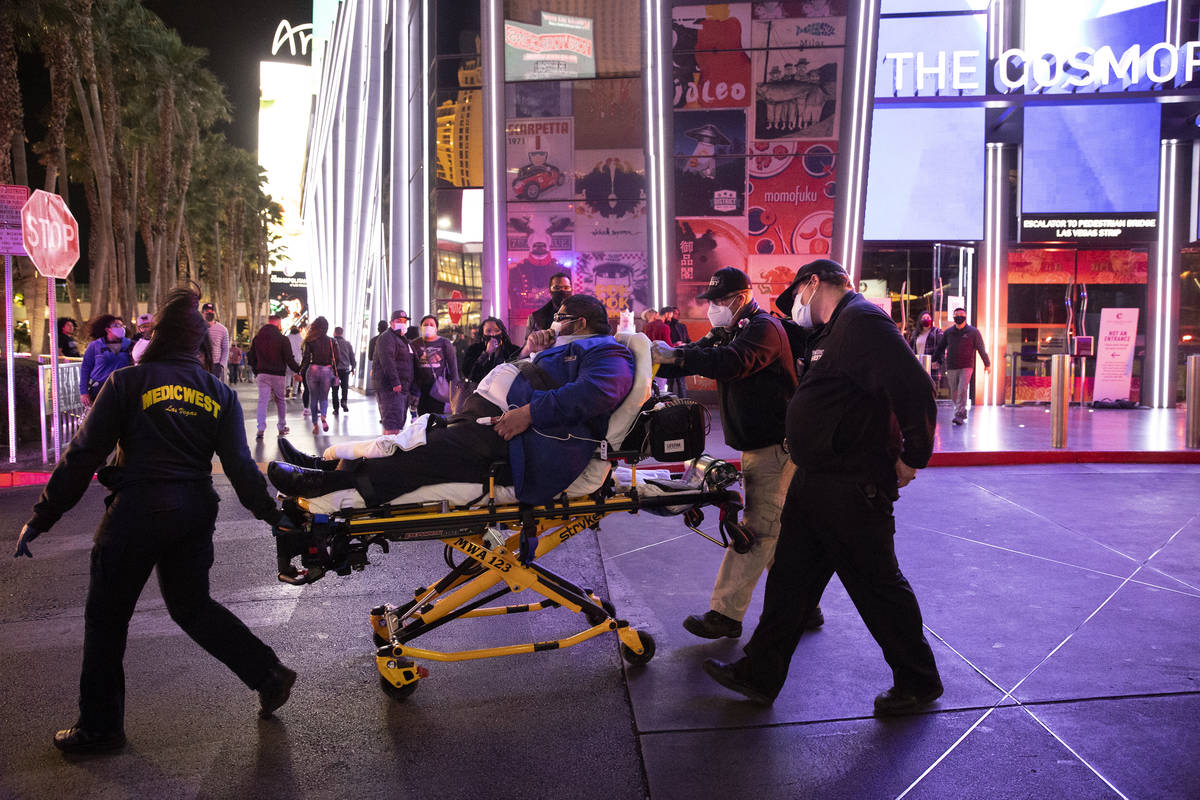 """A person is taken on a stretcher after emergency crews responded to a 2 alarm """"commercial fir ..."""