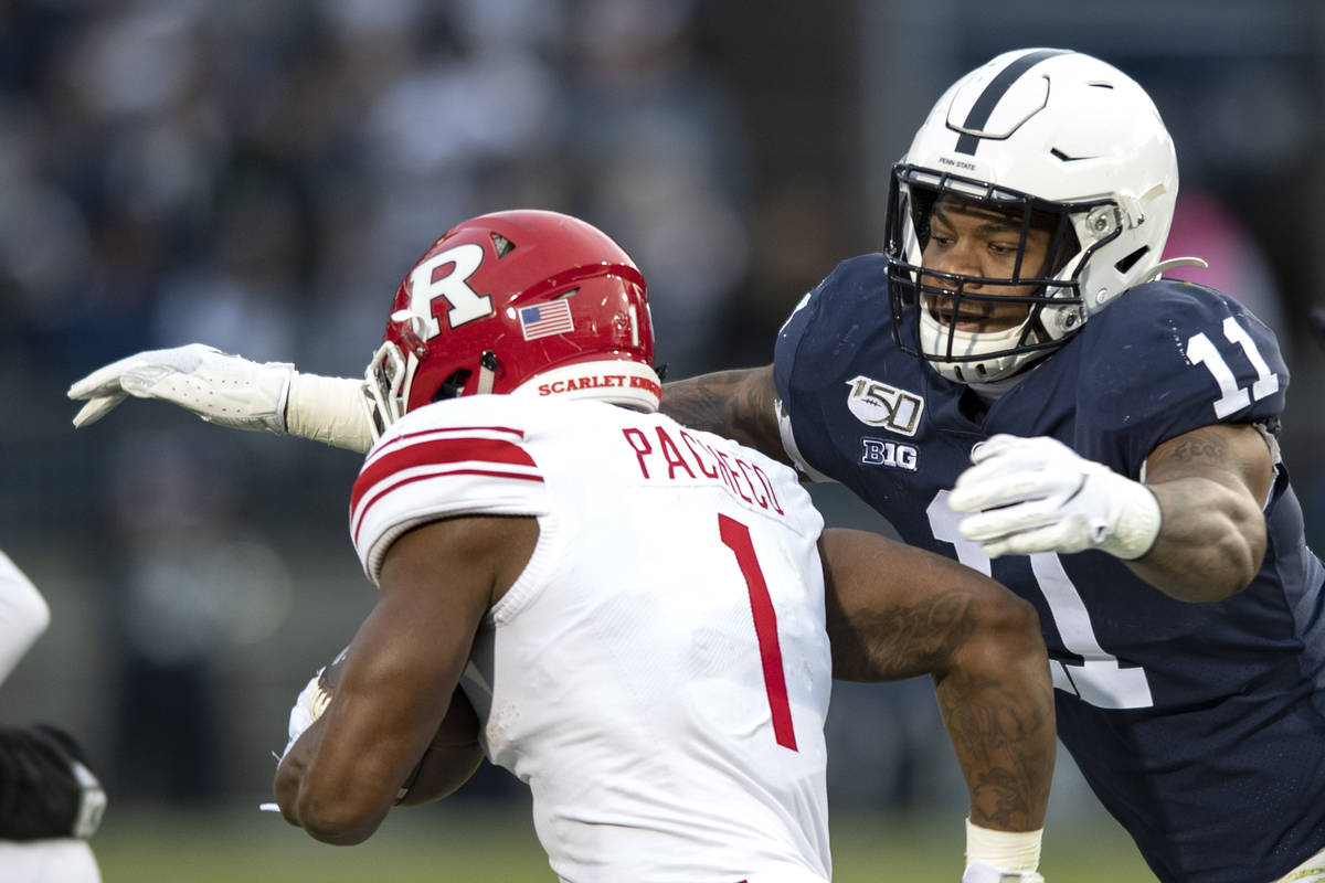 Penn State linebacker Micah Parsons (11) tackles Rutgers running back Isaih Pacheco during an N ...