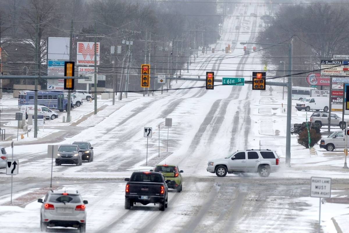 Snow covered city streets including at 61st and Sheridan in Tulsa as a winter storm moves in to ...