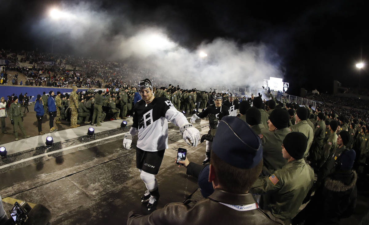 Los Angeles Kings defenseman Kurtis MacDermid is congratulated by cadets while heading back to ...