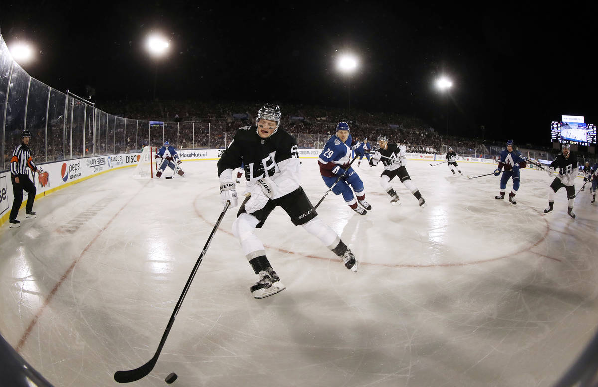 Los Angeles Kings left wing Austin Wagner, front, picks up the puck as Colorado Avalanche cente ...