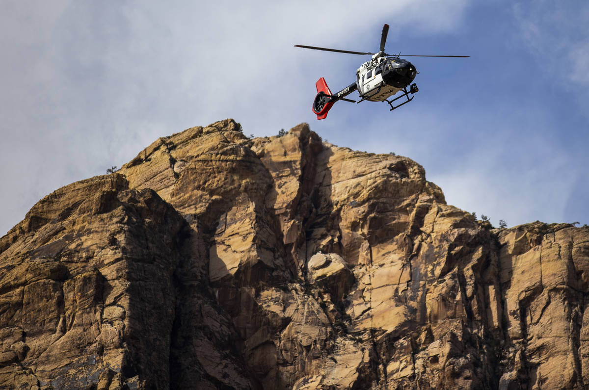 A Metro helicopter prepares to extract a climber that fell and seriously injured his leg at Pin ...