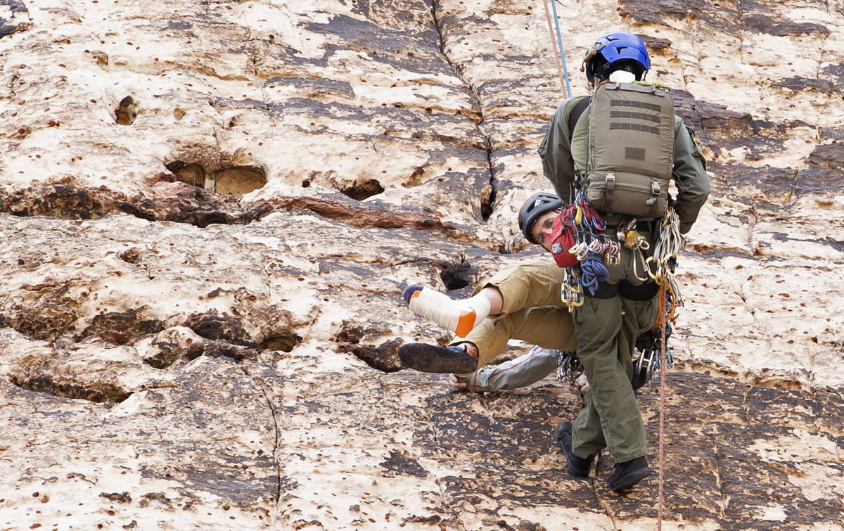 Las Vegas Metropolitan Police Department Search and Rescue lowers a climber to an extraction po ...