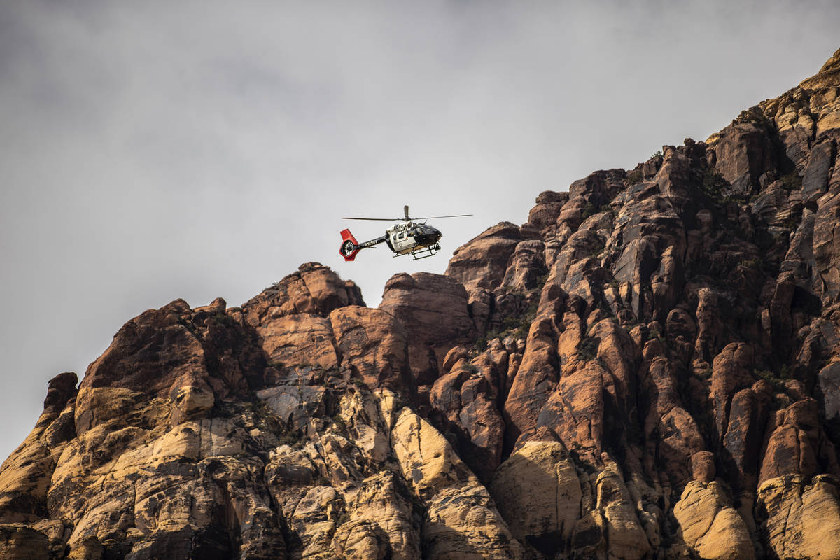 A Las Vegas Metropolitan Police Department Search and Rescue helicopter prepares to extract a c ...