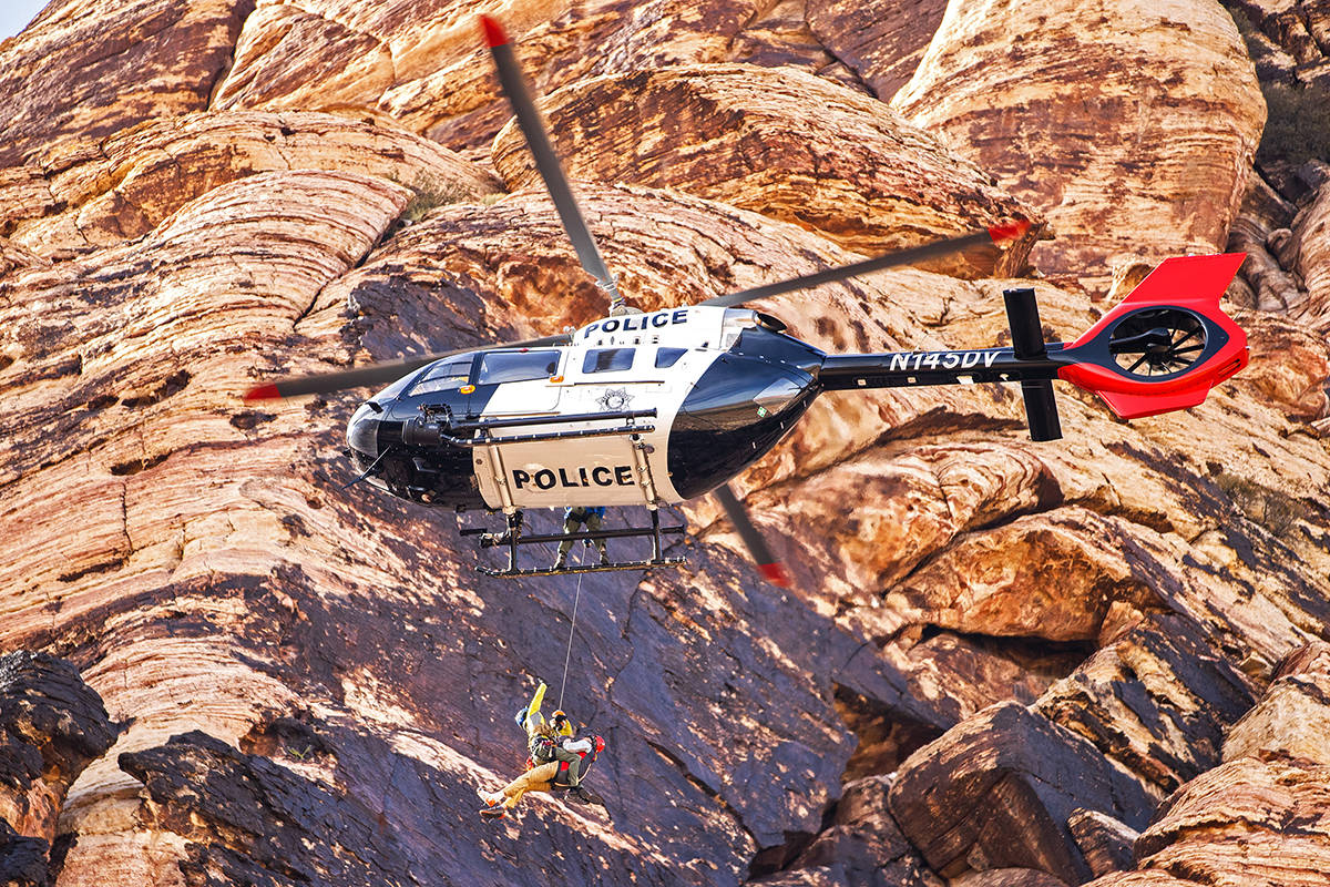 A climber is lifted to safety by Las Vegas Metropolitan Police Department Search and Rescue aft ...