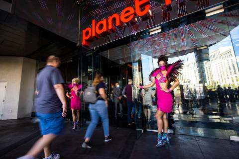Guests head to the casino at Planet Hollywood Resort in Las Vegas on Thursday, Oct. 8, 2020. ( ...