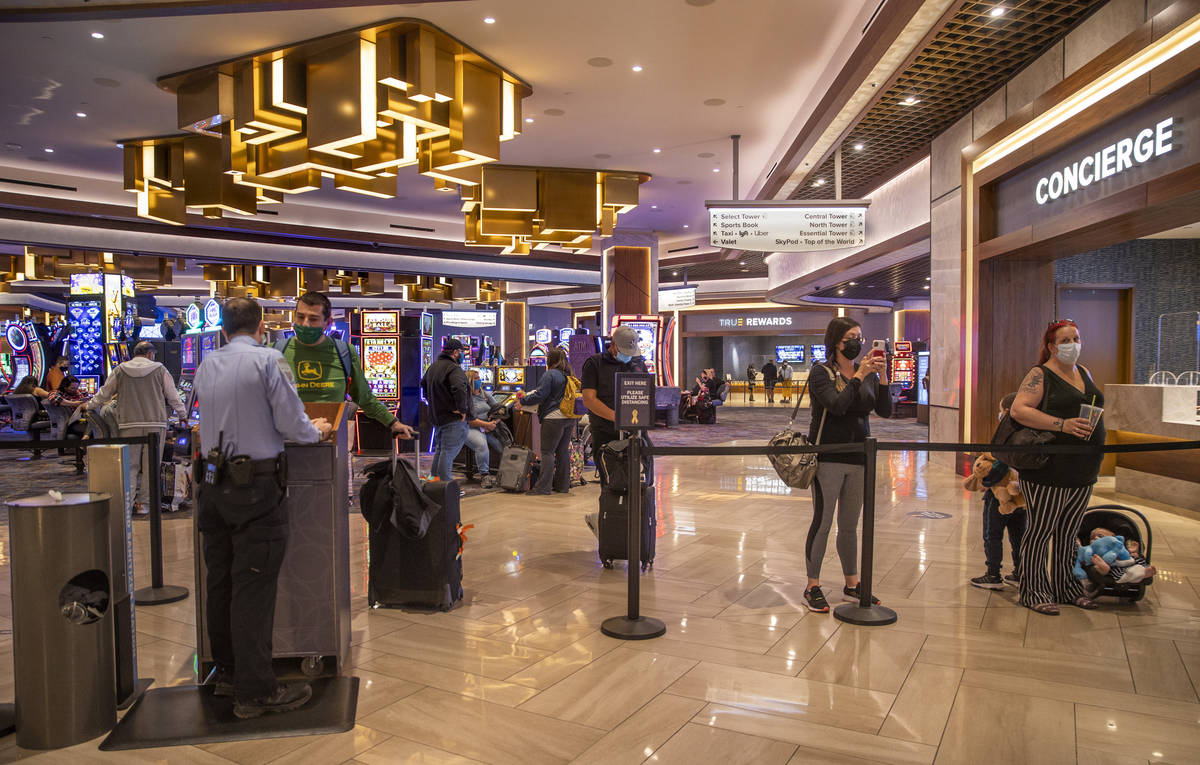 Visitors wait patiently in the slots area as someone checks in for them at the front desk withi ...