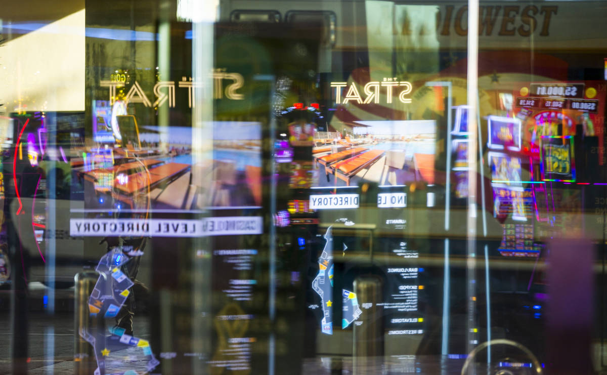 A variety of reflections about the main door at The Strat as casino floors have moved up to 35% ...