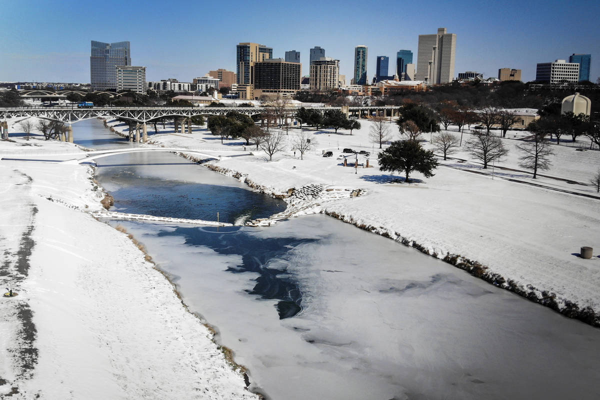 The Trinity River is mostly frozen after a snow storm Monday, Sept. 15, 2021, in Fort Worth, Te ...