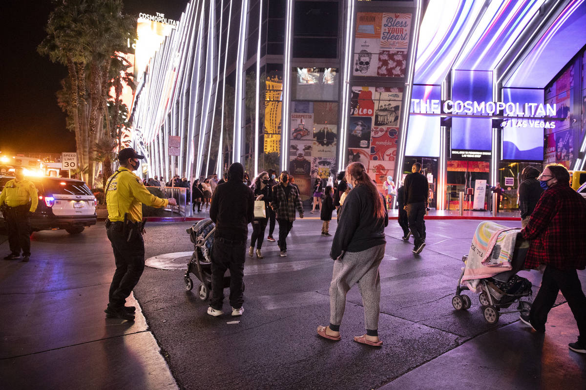 Emergency crews respond to a fire at The Cosmopolitan hotel-casino in Las Vegas, on Saturday, F ...