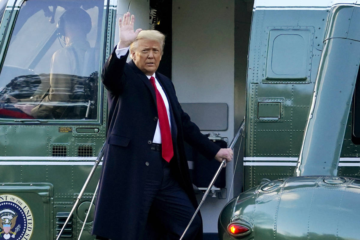 In this Wednesday, Jan. 20, 2021, file photo, President Donald Trump waves as he boards Marine ...