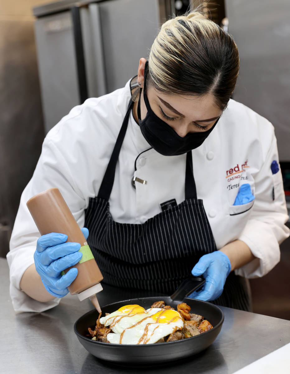 Chef Teresa Ramirez puts some finishing touches on a order of Prime Rib Hash, a menu item at th ...