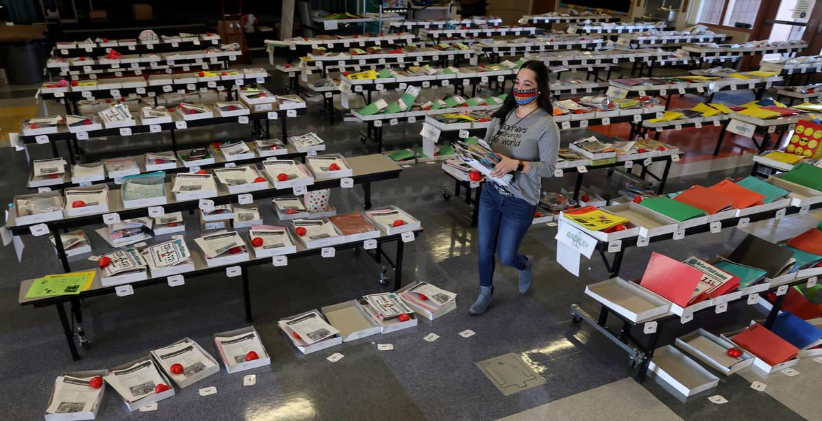 Kindergarten teacher Brianne Gomez prepares to deliver student materials during a school supply ...