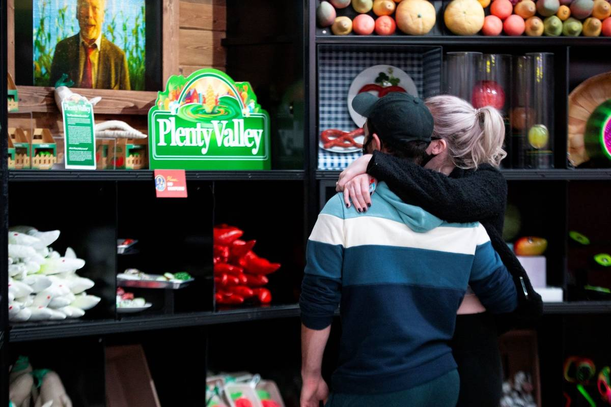A couple browses the produce section on opening day at the Omega Mart at Area15 on Thursday, Fe ...